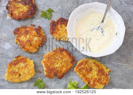 Vegetable patties  with cauliflower, chickpeas and sauce.