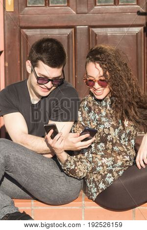 Young couple doing selfie in front of the house.