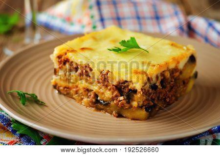 Potato minced meat eggplant casserole Moussaka on a wood background