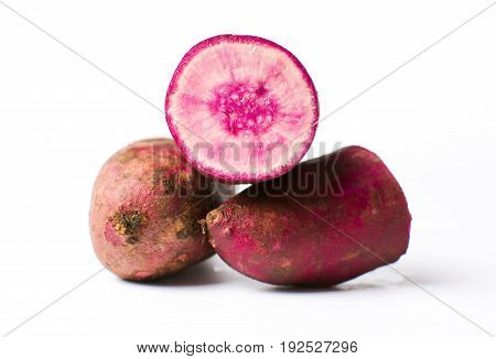 Raw Purple Potato Isolated On White Background
