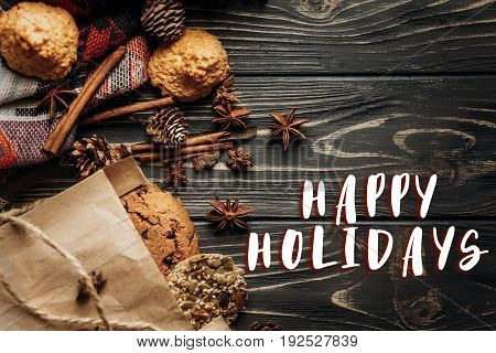 Happy Holidays Text Sign On Cookies Cupcakes And Spices On Wooden Background, Stylish Rustic Winter
