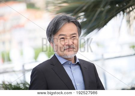 Kiyoshi Kurosawa attends the 'Before We Vanish (Sanpo Suru Shinryakusha)' photocall during the 70th annual Cannes Film Festival at Palais des Festivals on May 21, 2017 in Cannes, France.