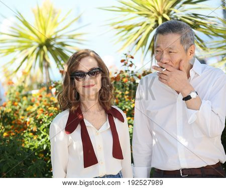 Hong SangSoo, Isabelle Huppert attend the 'Claire's Camera (Keul-Le-Eo-Ui-Ka-Me-La)' Photocall during the 70th annual Cannes Film Festival at Palais des Festivals on May 21, 2017 in Cannes, France.