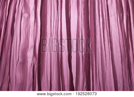 Fabric Texture Background Close Up of Transparent Magenta Curtain with Light.