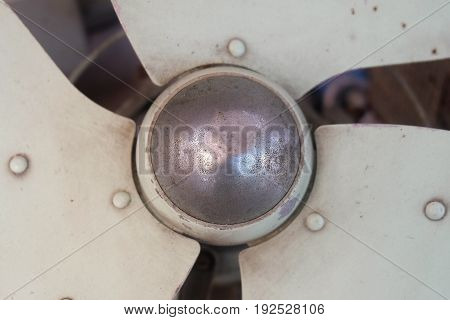 Close Up of Old Vintage Green Metal Electronic Fan Blade or Propeller Fan.