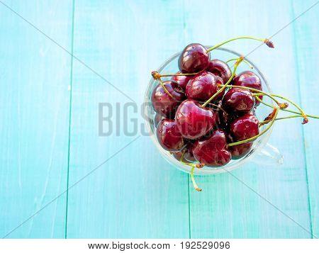 Cherries. Cherry. Cherries In Color Bowl And Kitchen Napkin. Red Cherry. Fresh Cherries. Cherry On W