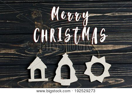 Merry Christmas Text Sign On Simple Christmas Eco Toys On Stylish Black Wooden Background. Space For