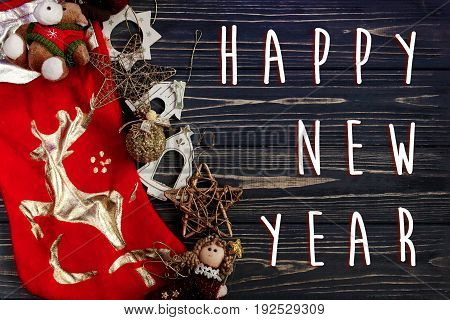 Happy New Year Text Sign On  Christmas Golden Stylish Toys On Red Stockings. Ornament Border On Blac