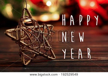 Happy New Year Text Sign On Christmas Golden Star On Background Of Garland Lights On Black Rustic Wo