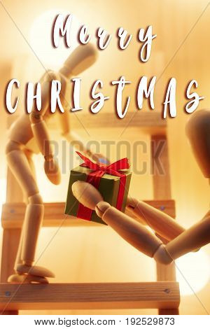 Merry Christmas Text Sign On Wooden Toy Giving Present Box  At Christmas Tree With Retro Lights.  Wi