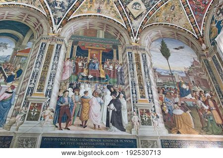 Italy Siena - December 26 2016: the view of the frescoes describes canonization of Catherine of Siena by Pope Pius II. Biblioteca Piccolomini of Siena Cathedral on December 26 2016 in Siena Tuscany Italy.
