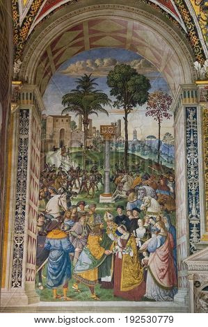 Italy Siena - December 26 2016: the view of the frescoes describes Enea Silvio bishop of Siena presents Eleonora of Portugal to Emperor Federico III. Biblioteca Piccolomini of Siena Cathedral on December 26 2016 in Siena Tuscany Italy.