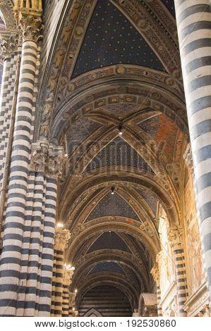 Italy Siena - December 26 2016: interior view of Metropolitan Cathedral of Santa Maria Assunta. Nave of Duomo di Siena on December 26 2016 in Siena Tuscany Italy.