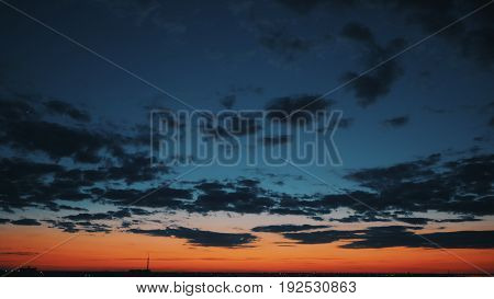 Dramatic view of the city's colorful sunset, cloudscape
