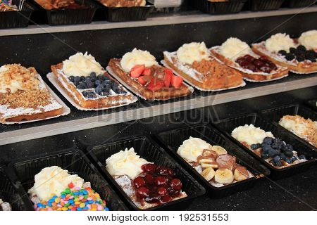 Fresh made Belgium waffles with various fruit toppings and cream