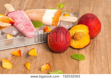Homemade Raspberries And Peach Popsicles