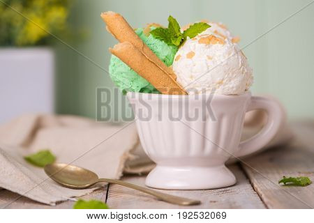 Vanilla And Mint Ice Cream In Cup