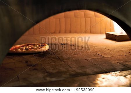 Gas fired Italian made pizza oven with pizza inside