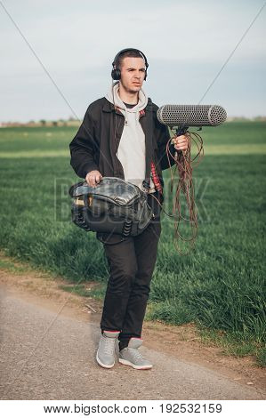 Behind The Scene. Sound Operator Technician With Boom Microphone Outdoor