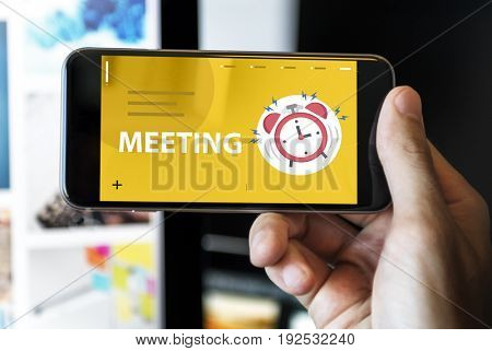Hands with illustration of alarm clock notification for important appointment on mobile phone