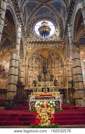 Italy Siena - December 26 2016: interior view of the Duomo di Siena. Altar area of Metropolitan Cathedral of Santa Maria Assunta on December 26 2016 in Siena Tuscany Italy.