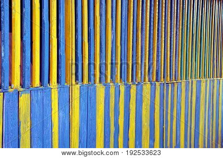 Yellow and green texture of wooden fence boards