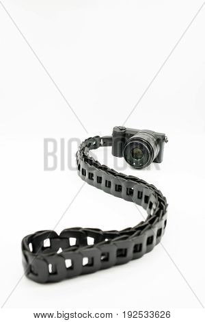 Nice curve of designed leather camera strap with digital camera over white background