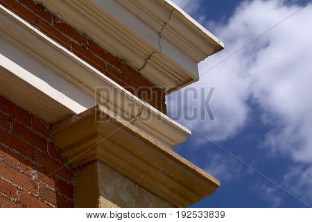 Nineteenth Century Building Facade with cumulous clouds and blue sky