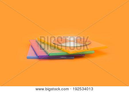 Several Dvd / Cd Boxes On Orange Background