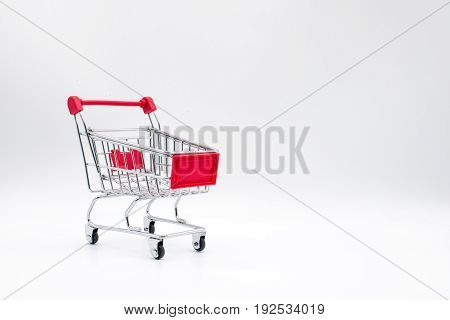 the miniature shopping cart isolated on background