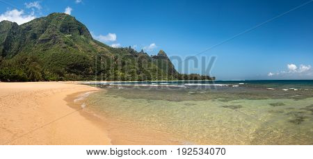 Panoramic view down the sand at Tunnels Beach in summer on Hawaiian island of Kauai on North Shore