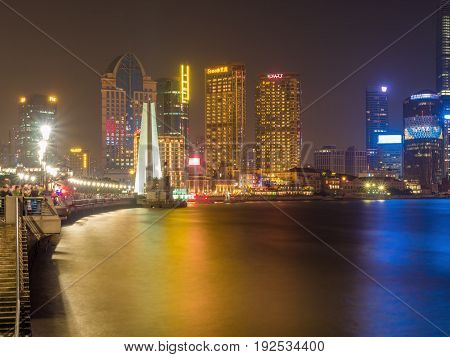Shanghai, China - Nov 4, 2016: Shanghai City skyline by night. Features the shoreline and Huangpu River. Long exposure, available-light image. Popular tourists venue.