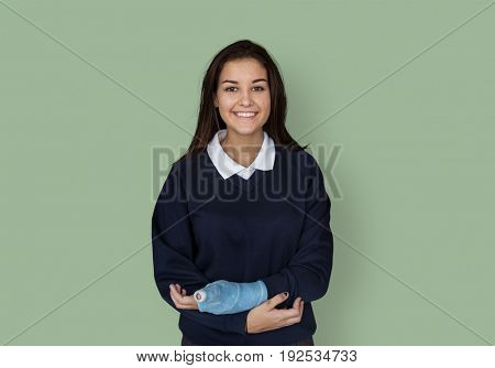Young Student in Uniform with Broken Arm Studio Portrait