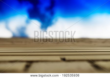 Horizontal brick wall with blue sky motion blur background hd
