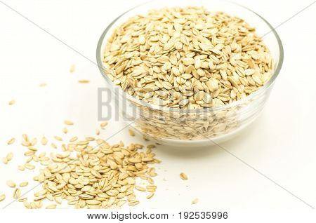 oatmeat porridge cereal flakes in a crystal bowl on white background