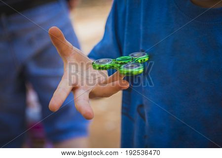 Young Boy Play With Fidget Spinner