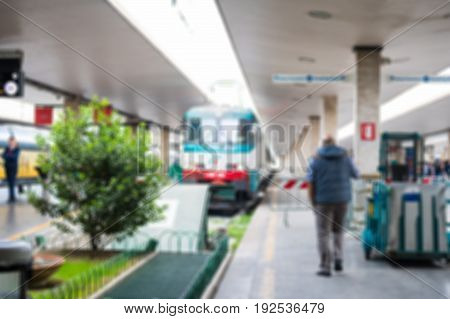 Blurred image bokeh of Train at the platform in Firenze Santa Maria Novella railway station in Florence Italy.