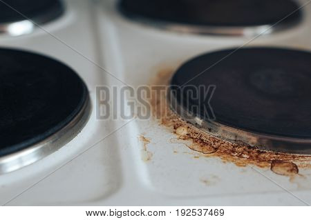 electric cooker dirty pancakes with rust and grease.
