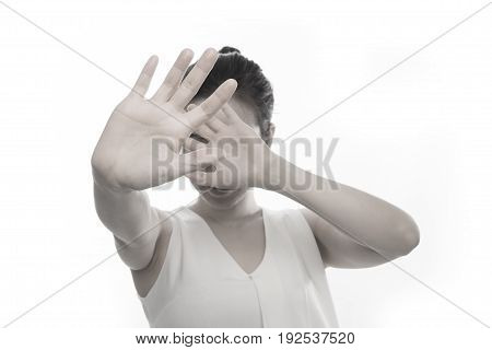 young woman raise hand on isolated white background concept of stop violence against women.
