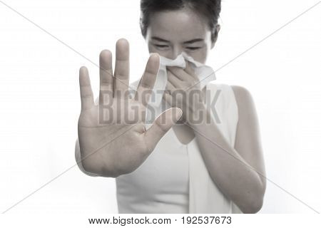 young asian woman sneezing on isolated white background. concept of healthcare.