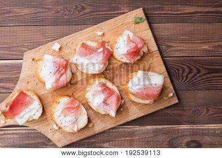 Sandwich with bacon on board