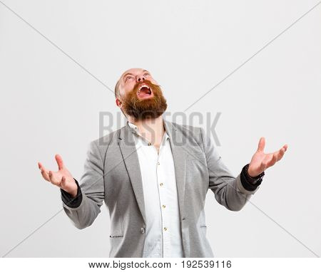 Disgruntled screaming man looking up