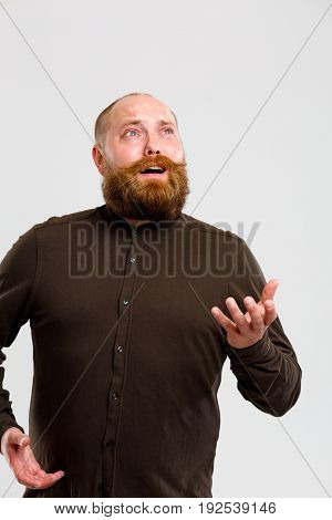 Man in shirt looks up