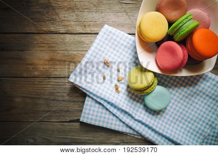 Closeup colorful macarons or macaroons with copy space