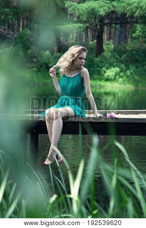 beautiful young woman relaxing outdoors