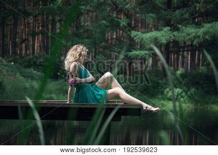 beautiful young woman relaxing outdoors