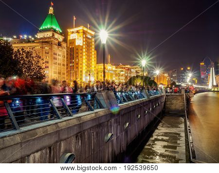 Shanghai, China - Nov 4, 2016: Night view of Sassoon House and Bank of China buildings (left to right) along The Bund on Zhongshan East 1st Road. Some haze can still be seen.