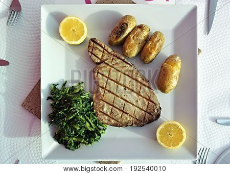 Tuna Steak With Batatas A Murro And Broccoli