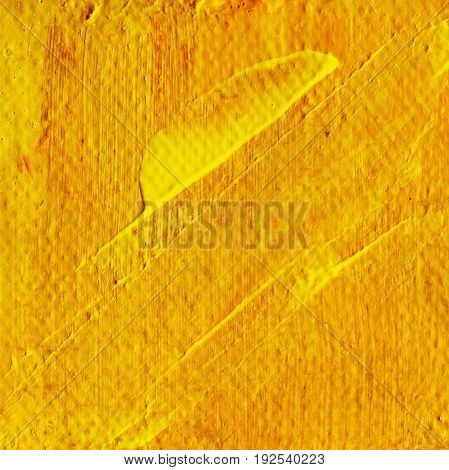 Abstract yellow orange acrylic hand paint background. Part of oil painting with brush strokes. Background of detail of yellow acrylic painting.