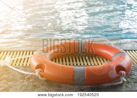 Floating tires stay on side swiming pool